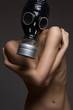 Nude woman in exclusive gas mask