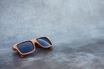 wooden sunglasses and grunge background