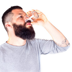 bearded man drinking