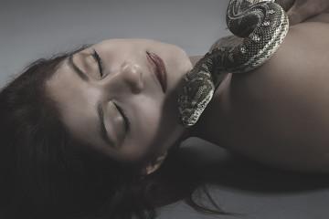 Sensual, beautiful woman with an Australian python