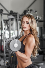 Fitness model pumping up muscles