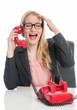 canvas print picture - Blonde Geschäftsfrau telefoniert am Schreibtisch