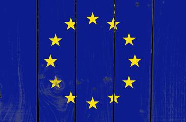 European Union flag on wooden background