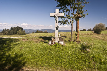 cross on the mountain meadow in Javorniky Mts.
