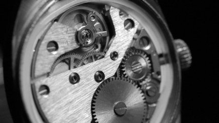 Mechanism inside an old watch. Black and white.