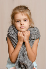 Diseased five year old girl wrapped in a scarf