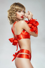 Sexy woman bound with red gift ribbon