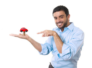 young happy attractive man thinking of buying a new car