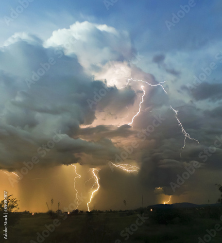 A Chaotic Thundercloud with Lightning Strikes Within - 69094917