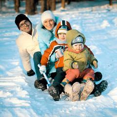 young family sledding
