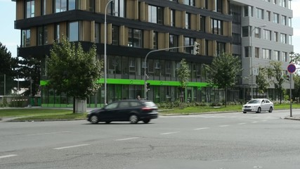 busy street with cars in city - modern building (offices)