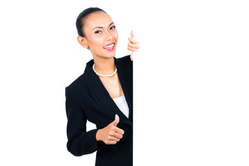 Asian businesswoman showing empty white board