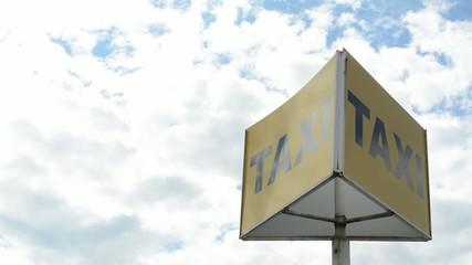 taxi sign - cloudy sky