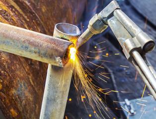 worker cutting steel