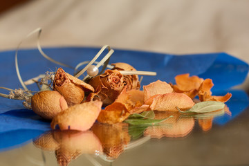 Dried roses on the blue paper. Dry flowers collection.