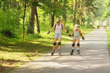 Mom and daughter rollerblade