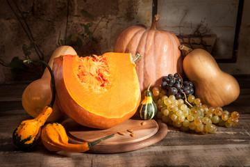 Pumpkin cut, gourds and grapes