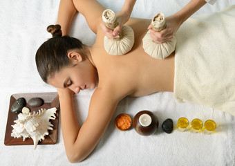 portrait of young beautiful woman in spa environment, massage wi