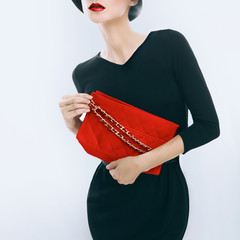 Retro style. Elegant glamor lady with clutches