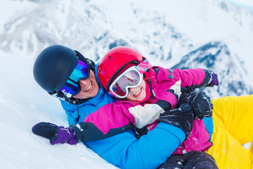 Father and child in ski equipment