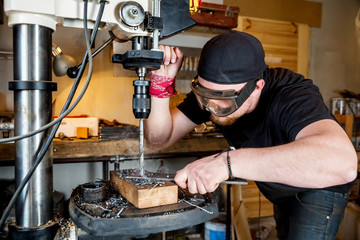 Man in work on electric drill press