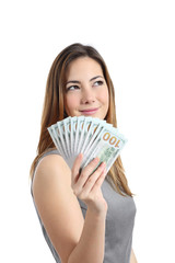 Business woman thinking and holding money