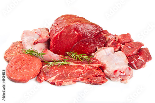 Foto op Canvas Vlees Fresh butcher cut meat assortment garnished