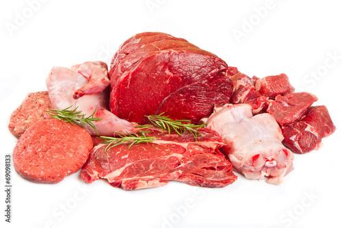 Fresh butcher cut meat assortment garnished - 69098133