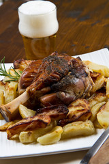 pork knuckle baked with  potatoes