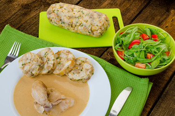 Chicken in cream sauce with dumplings