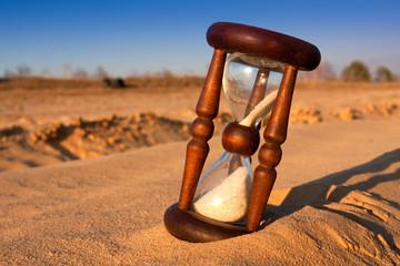 hourglass in desert's sand