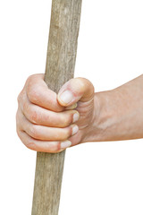 peasant hand holds old wooden cudgel