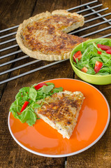 French quiche with cheese and salad
