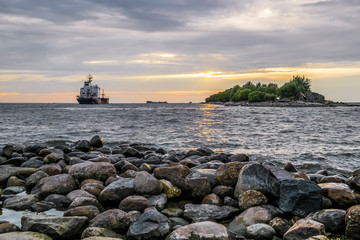 The ship goes to sea from the port of St. Petersburg at sunset