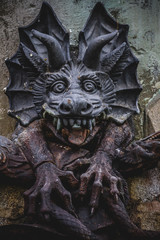 devil figure, bronze sculpture with demonic gargoyles and monste
