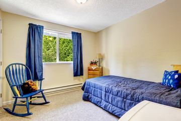 Bright ivory room with blue curtains and bed