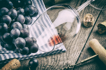 Retro setting with empty wine glass and grapes