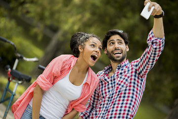 Young couple taking photo with mobile phone