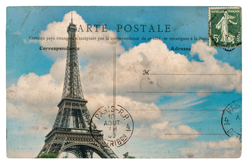 vintage postcard from paris with eiffel tower over blue sky