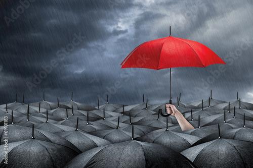 Leinwanddruck Bild red umbrella concept