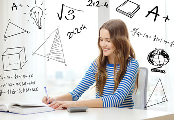 student girl with book, notebook and calculator