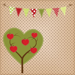 Apple tree in the shape of a heart with bunting or banner