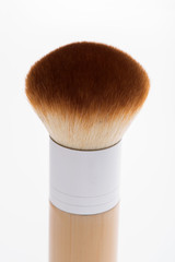 Professional  wooden make-up brush isolated on white background