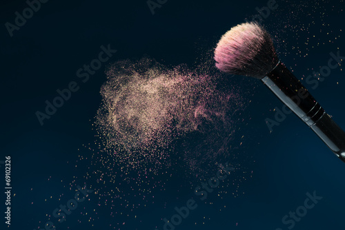 canvas print picture Professional black make-up brush with pink powder in motion isol