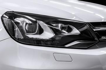 Closeup headlights of car. Car exterior detail.