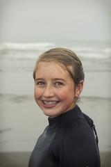 Girl wearing wet suit on Rockaway beach Oregon