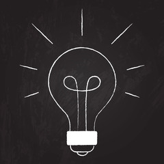 Hand drawn light bulb on the chalkboard. Vector illustration of
