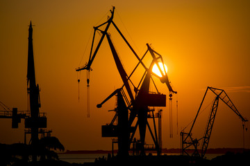 Shipyard cranes at sunset at Pula, Istria, Croatia