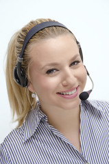 Beautiful blonde operator smiling with headset