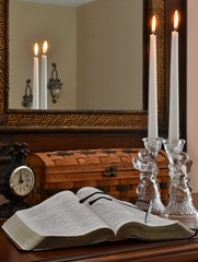 Open Bible with Glass Angels, Lit Candles and Clock